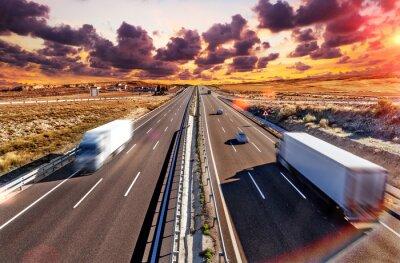 Posters Camiones y autovia.Transporte internacional et logistica.Mercancia llegando a su destino por carretera. Industria del transporte