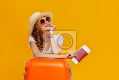 Posters concept of travel. happy woman girl with suitcase and  passport on  yellow background.