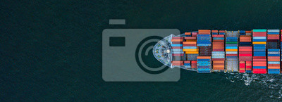 Posters Container ship carrying container for import and export, business logistic and transportation by container ship in open sea, Aerial view container ship with copy space for design banner web