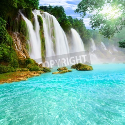Posters Detian or Ban Gioc waterfall along Vietnamese and Chinese board.