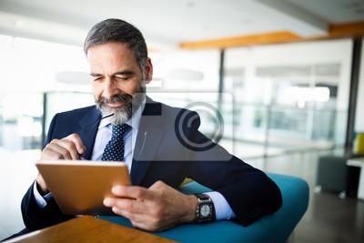 Posters Elegant business multitasking multimedia man using devices