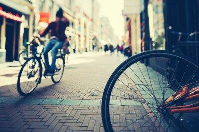 Posters Faire du vélo à Amsterdam au coucher du soleil