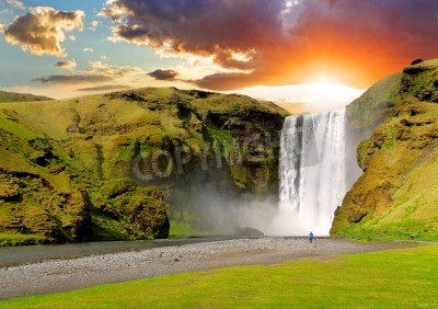 Posters famous waterfall Skogafoss in Iceland at sunset