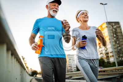 Posters Fitness, sport, people, exercising and lifestyle concept - senior couple running
