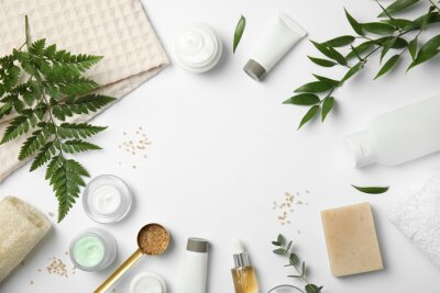 Posters Flat lay composition with different body care products and space for text on white background