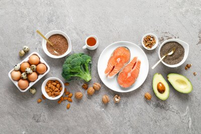 Posters Food sources of omega 3 acids. Foods high in healthy fat, vitamin and antioxidants. Top view.