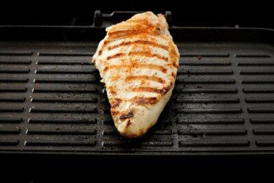 Fresh food on black grill