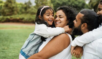 Posters Happy indian family having fun outdoor - Hindu parents laughing with their children at city park - Love concept - Main focus on mother and daughter face