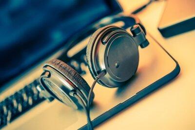 Posters Headphones on Laptop
