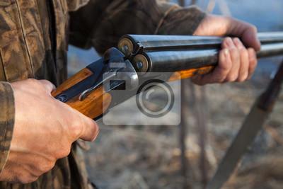 Posters Hunter chargeant un pistolet à double canon