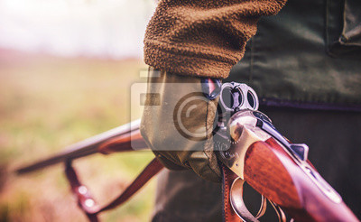 Posters Hunter with a rifle in hunting