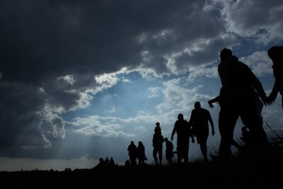 Posters Immigration of people blue sky with dark clouds
