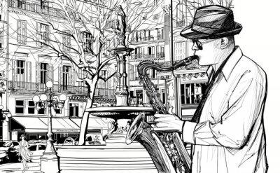 Posters joueur de saxophone dans une rue de Paris