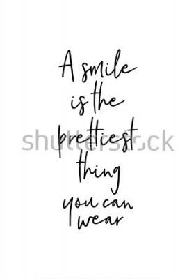 Posters Lettrage dessiné à la main. Illustration d'encre. Calligraphie au pinceau moderne. Isolé sur fond blanc Un sourire est la plus jolie chose que vous puissiez porter.