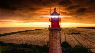 Posters Leuchtturm Fluegge mit Sturmfornt