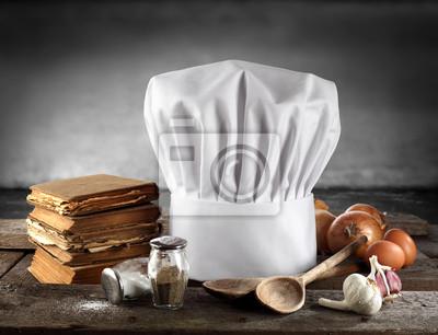 livres de cuisine et bonnet blanc