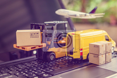 Posters Logistics, supply chain and delivery service concept : Fork-lift truck moves a pallet with box carton. Van on a laptop computer, depicts wide spread of products around globe in ecommerce popular era