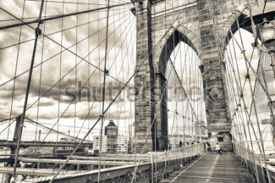 Posters Magnificent structure of Brooklyn Bridge with sunset sky - NYC.