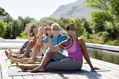 Posters Mature group of people doing yoga exercise