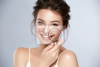 Posters model with perfect smile and beautiful face isolated on grey