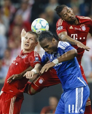 Posters MUNICH, May 19 - Drogba of Chelsea (M) between Schweinsteiger (L) and Boateng (R) of Bayern during FC Bayern Munich vs. Chelsea FC UEFA Champions League Final game at Allianz Arena on May 19, 2012 in