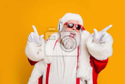 Posters Nightclub invite on christmas party celebration funky crazy santa claus dj in white headset sing song sound melody listen music dance wear stylish x-mas hat suspenders isolated yellow color background