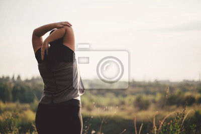Posters Overweight woman stretching hands relaxing while walking outdoors. Weight loss and active lifestyle concept