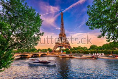 Posters Paris Eiffel Tower and river Seine at sunset in Paris, France. Eiffel Tower is one of the most iconic landmarks of Paris.