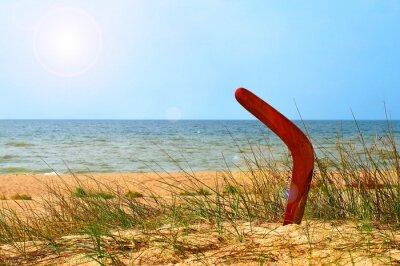 Posters Paysage avec un effet boomerang sur la plage de sable envahi.