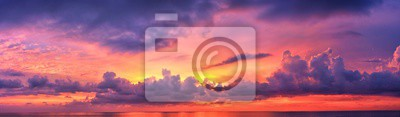 Posters Phuket beach sunset, colorful cloudy twilight sky reflecting on the sand gazing at the Indian Ocean, Thailand, Asia.