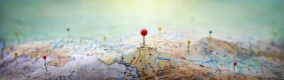 Posters Pins on a geographic map curved like mountains. Pinning a location on a map with mountains. Adventure,  geography, mountaineering, hike and travel concept background.