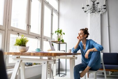 Posters Portrait of a smiling creative woman in a modern loft space