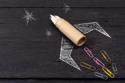 Posters School stationery supplies and hand drawn rocket ship on dark background. Back to school concept. New idea and creativity launching