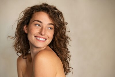 Posters Smiling beauty woman with freckles looking away