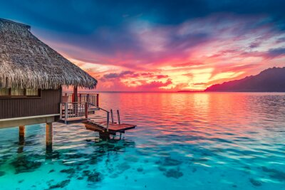Posters Stunning colorful sunset sky with clouds on the horizon of the South Pacific Ocean. Lagoon landscape in Moorea. Luxury travel.