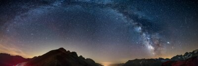 Posters The Milky Way arch starry sky on the Alps, Massif des Ecrins, Briancon Serre Chevalier ski resort, France. Panoramic view high mountain range and glaciers, astro photography, stargazing