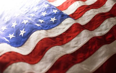 Posters USA background of waving American flag. For 4th of July, Memorial Day, Veteran's Day, or other patriotic celebration.