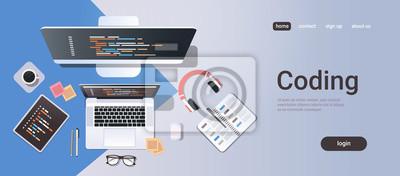 Posters web site design development program coding concept top angle view desktop computer monitor tablet laptop screen organizer office stuff horizontal copy space