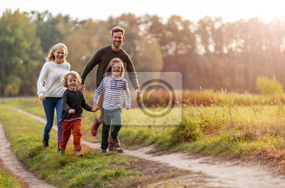 Posters Young family having fun outdoors