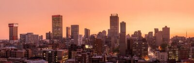 Sticker A beautiful and dramatic panoramic photograph of the Johannesburg city skyline, taken on a golden evening after sunset.