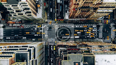 Sticker Aerial view of New York downtown building roofs. Bird's eye view from helicopter of cityscape metropolis infrastructure, traffic cars, yellow cabs moving on city streets and crossing district avenues