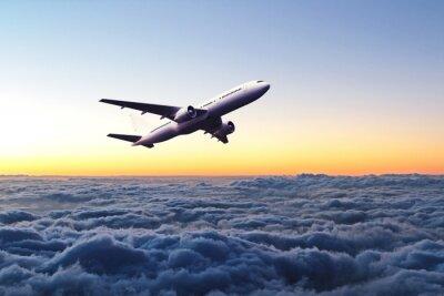 Sticker Avion dans le ciel au lever du soleil