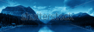 Sticker Banff national park Lake Louise sunrise panorama with mountains and forest in Canada.