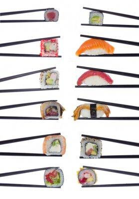 Sticker Beaucoup de rouleaux de sushi à baguettes isolé sur fond blanc