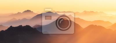 Sticker Berggipfel der Alpen im Abendlicht