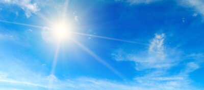Sticker Blue sky. Bright midday sun illuminates the space. Wide photo .