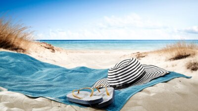 Sticker blue towel with hat and summer beach