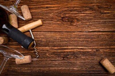 Sticker Bouteille de vin, tire-bouchon et bouchons sur la table en bois. Contexte