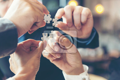 Sticker Businessman team work holding two jigsaw connecting couple puzzle piece for matching to goals target, success and start up new project in office, select focus. Business Concept.