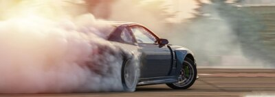 Sticker Car drifting, Blurred  image diffusion race drift car with lots of smoke from burning tires on speed track.
